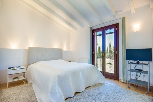 Cosy bedroom with bpanoramic windows