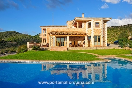 Elegant newly built country house made of natural stone with distant views in Son Macia