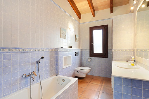 Bathroom with bathtub in tranquile blue colors