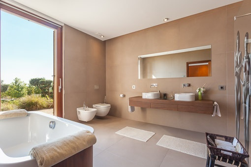 Design bathroom with bath tub and panorama window