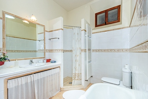 Bathroom with shower and bath tub