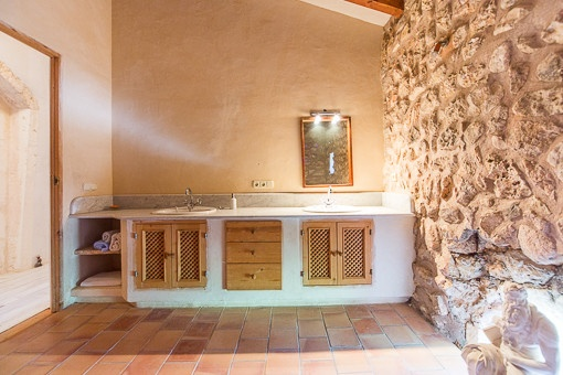 Nice bathroom with natural stone wall