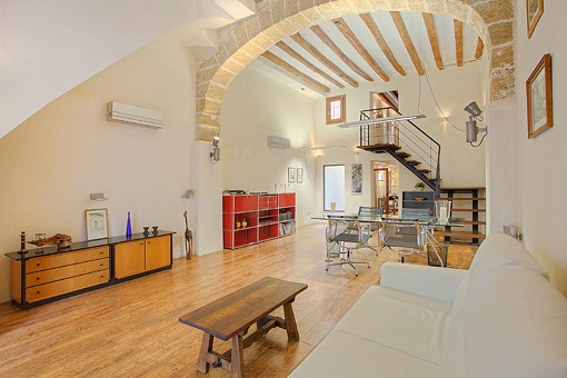 Spacious living and dining area with high ceilings