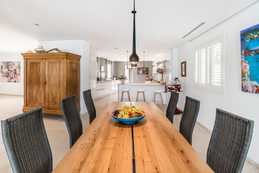 Spacious dining area beside the open kitchen
