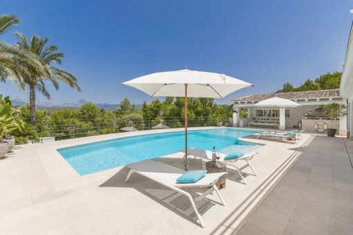 Sunny pool area with fantastic views