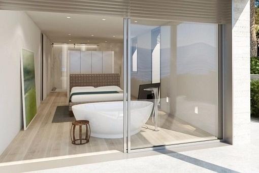 Bedroom with balcony and bathtub