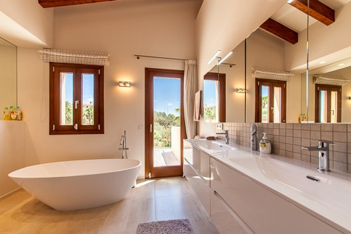 Elegant bathroom with freestanding bath tub