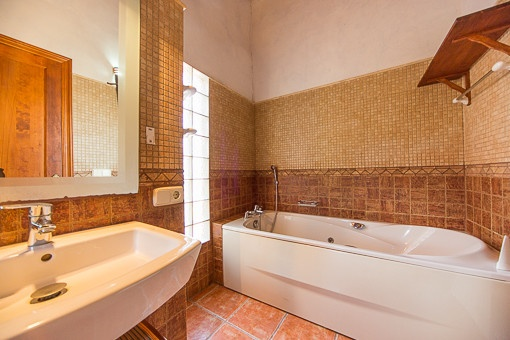 Bright master bedroom with bath tub