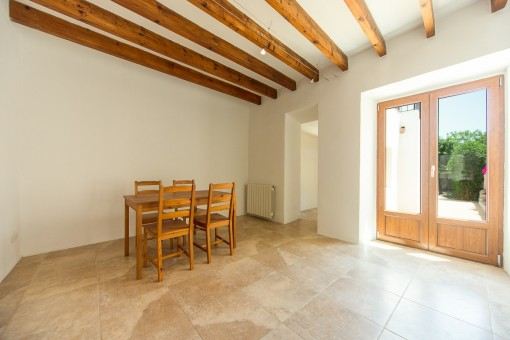 Bright dining area with access to the garden