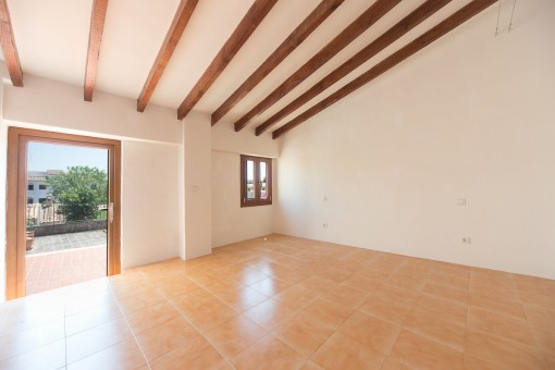 Spacious master bedroom with access to terrace