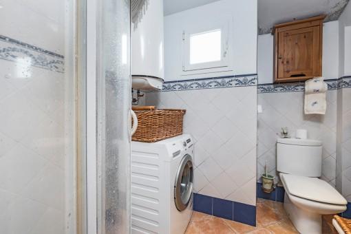 Shower bathroom with wasching machine
