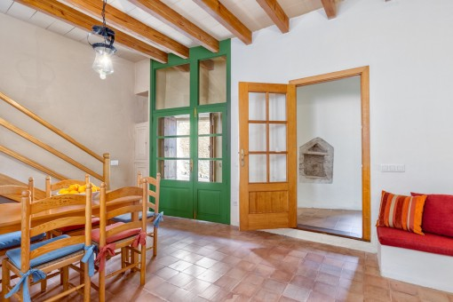 Spacious entrance area with wooden doors
